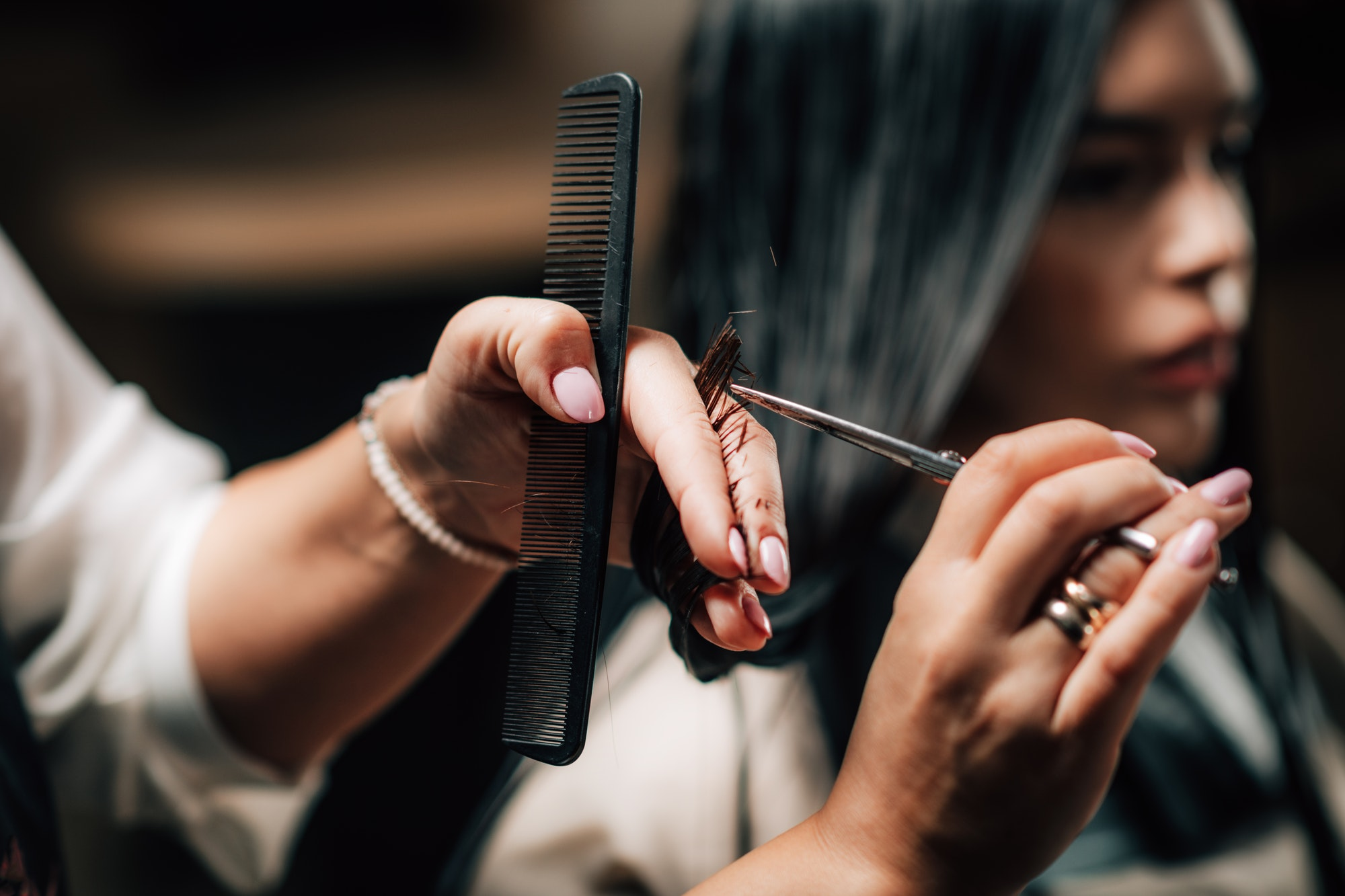 Beautiful Young Woman in Hair Salon